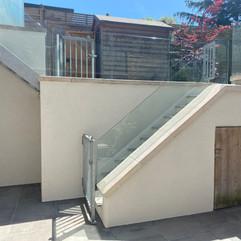 Silicone Render Installation to garden courtyard in 'Silver'. showcasing 'Silver'