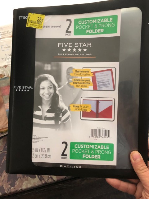 lady holding 5 star folder with clearance sticker