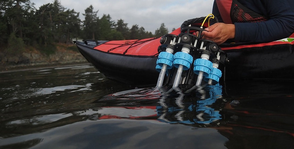 Image of microplastics depth profiling technology being lowered into the water from a kayak