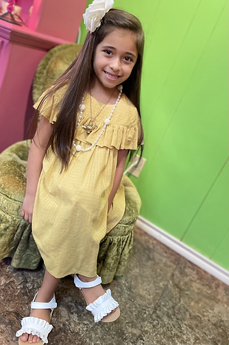 Girl in Mable + Honey Mustard Muslin Dress