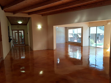 Micro-Crete Concrete Flooring with a Tan Concrete Acid Stain by Concretewise.