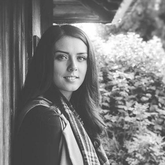 Black and white portrait of Stephanie Stephens smiling