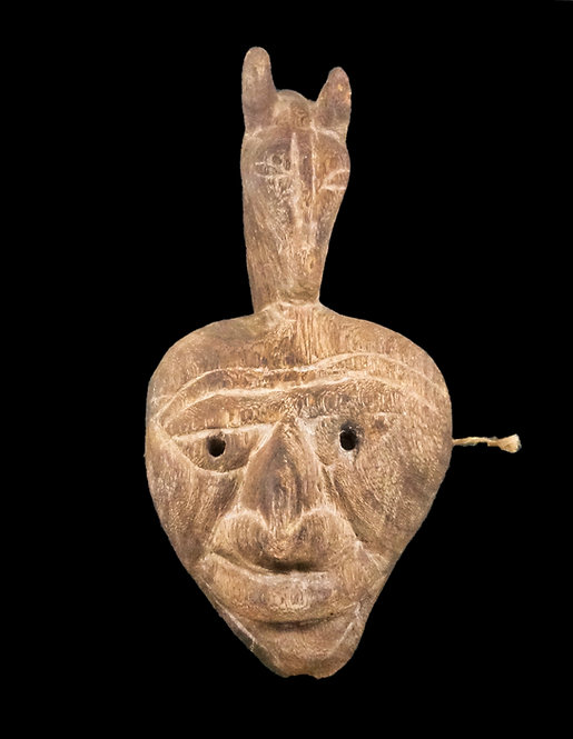 Mask in shape of man's face with horse's head on top.