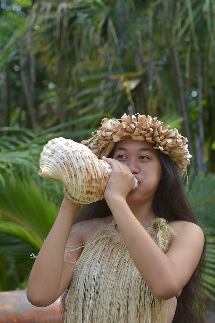 Polynesian Cook Islander  woman blowing