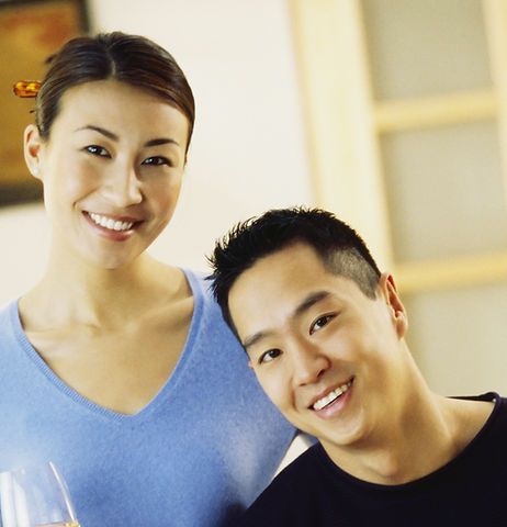 smiling asian couple