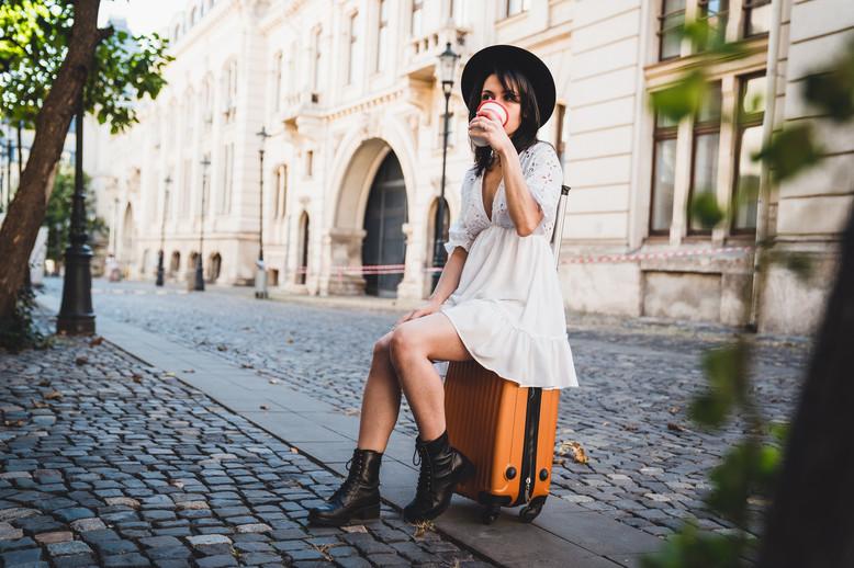 Fashion woman traveler wearing hat and w