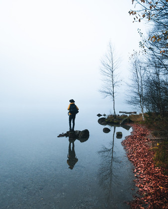 Young hiker sitting by the lake