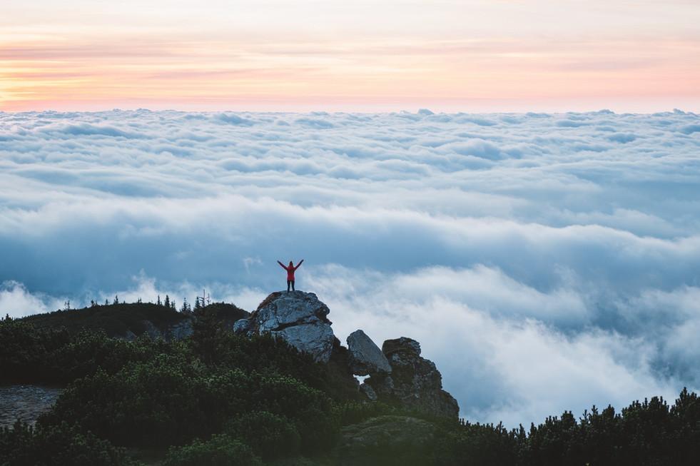 Young woman hiker enjoy the view on moun