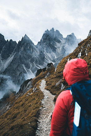 Hiker looking at view, Dolomites, Italy