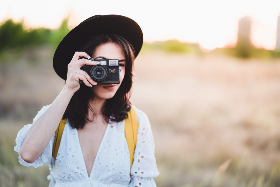 Young woman taking a photo with vintage
