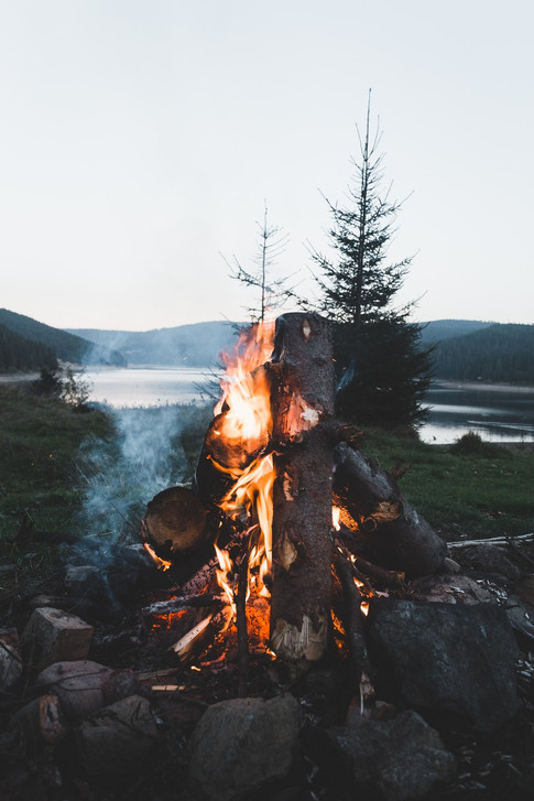 Glowing camp bonfire  and romantic moody