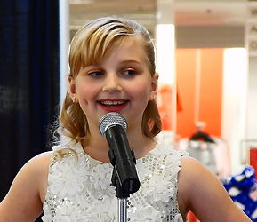 "Ella Violet preforming ""Santa Baby"" at the All That Glitters is Glam Fashion Show"