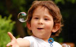 happy_child_touching_bubble-1680x1050.jpg