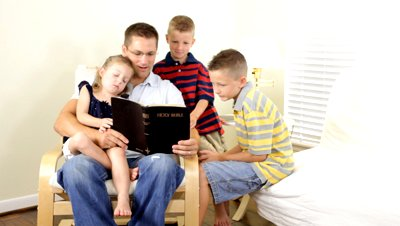 stock-footage-a-father-reads-to-his-children-from-the-holy-bible.jpg