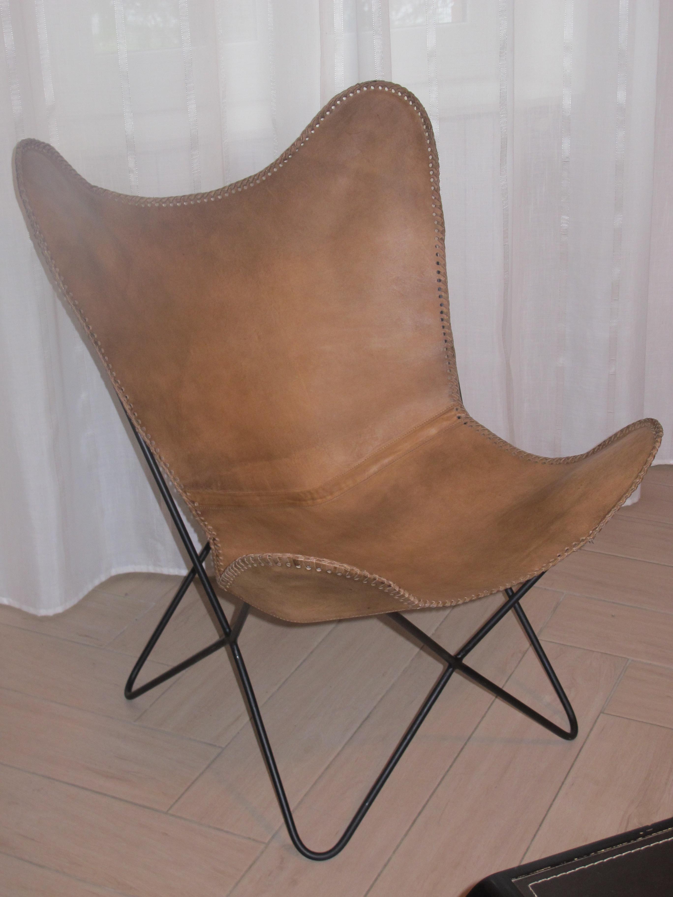 fauteuil cuir papillon
