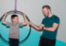 Father and son in an aeial hoop