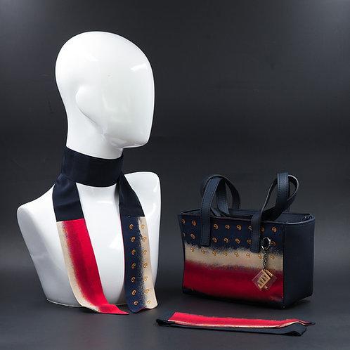 Borsa a spalla in vera pelle blue inserti in setacon stampa geometrica, suitoni blu, bianchi e rossi e manici in pelle