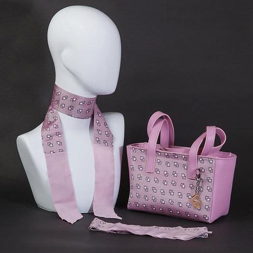 Borsa a spalla in pelle rosaeinserti in seta con stampa geometrica, bianco e nero con manici in vera pelle rosa