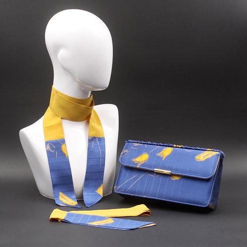 Clutch bag bluette, pochette rigidablu fiordalisoin seta rigata con stampa floreale gialla