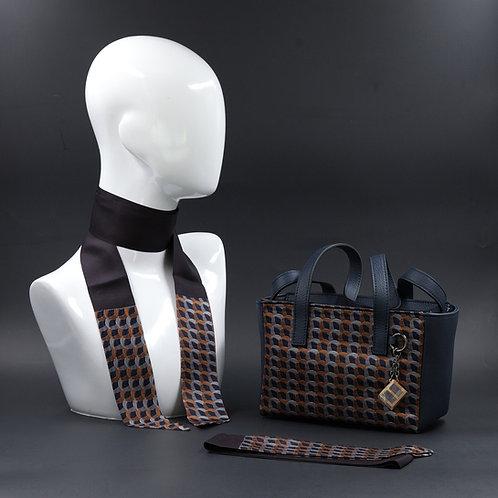 Borsa a spalla in vera pelle blu einserti in seta con stampa geometrica, suitoni del grigio e arancione e Manici in pelle