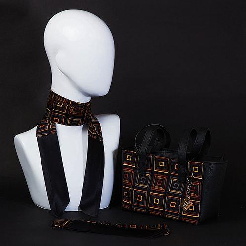 Borsa a spalla in verapelle nerae inserti in seta con stampa geometrica