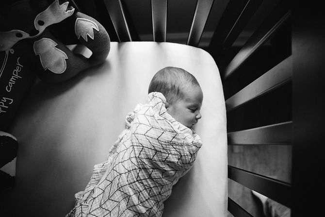 Newborn baby in the crib