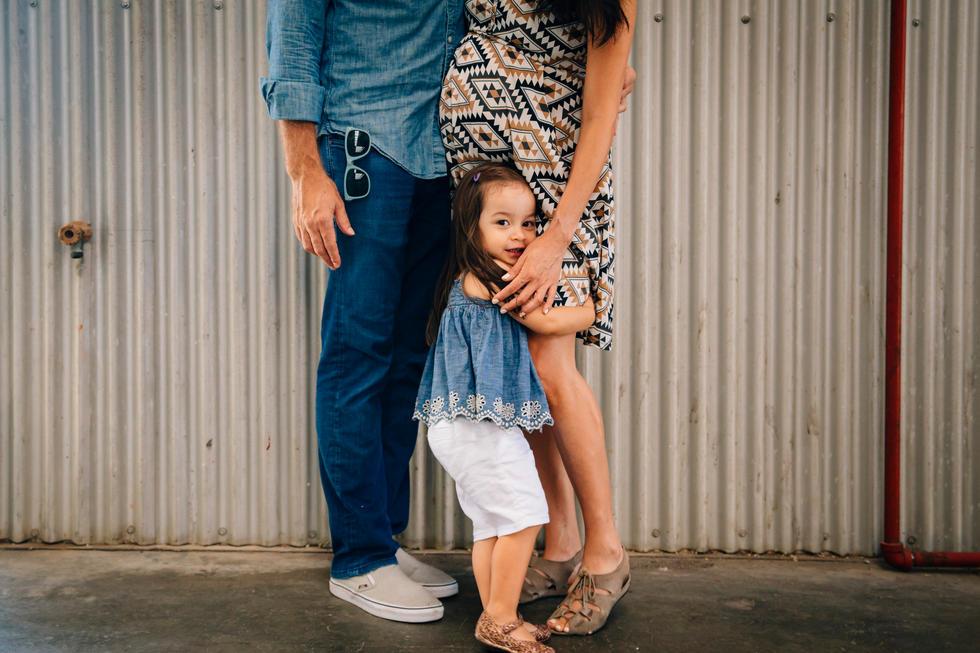 Little girl hugging her parents
