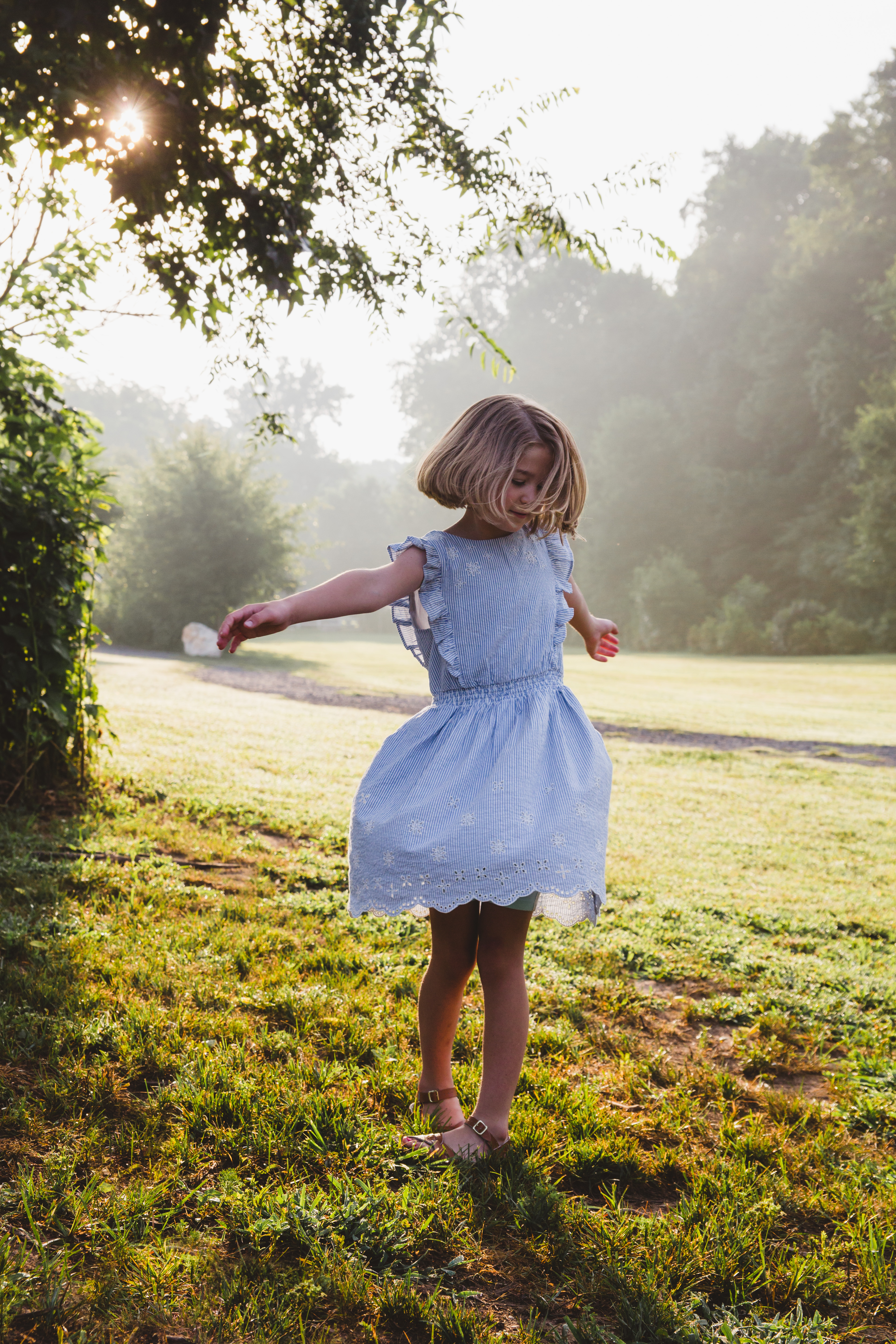 Girl twirling in the park