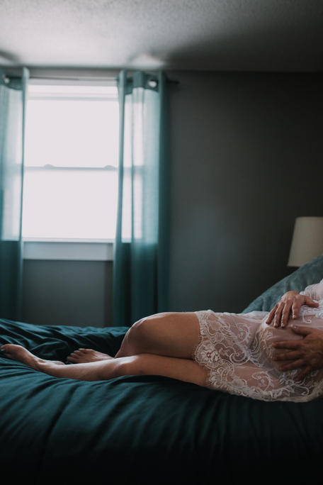 Pregnant mom on the bed