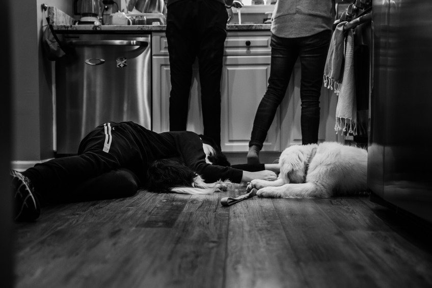 boy with his dog on the floor
