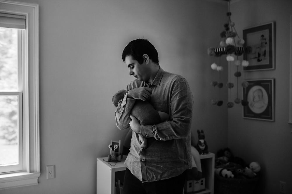 Dad in nursery with newborn