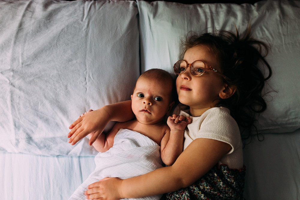sister with newborn brother
