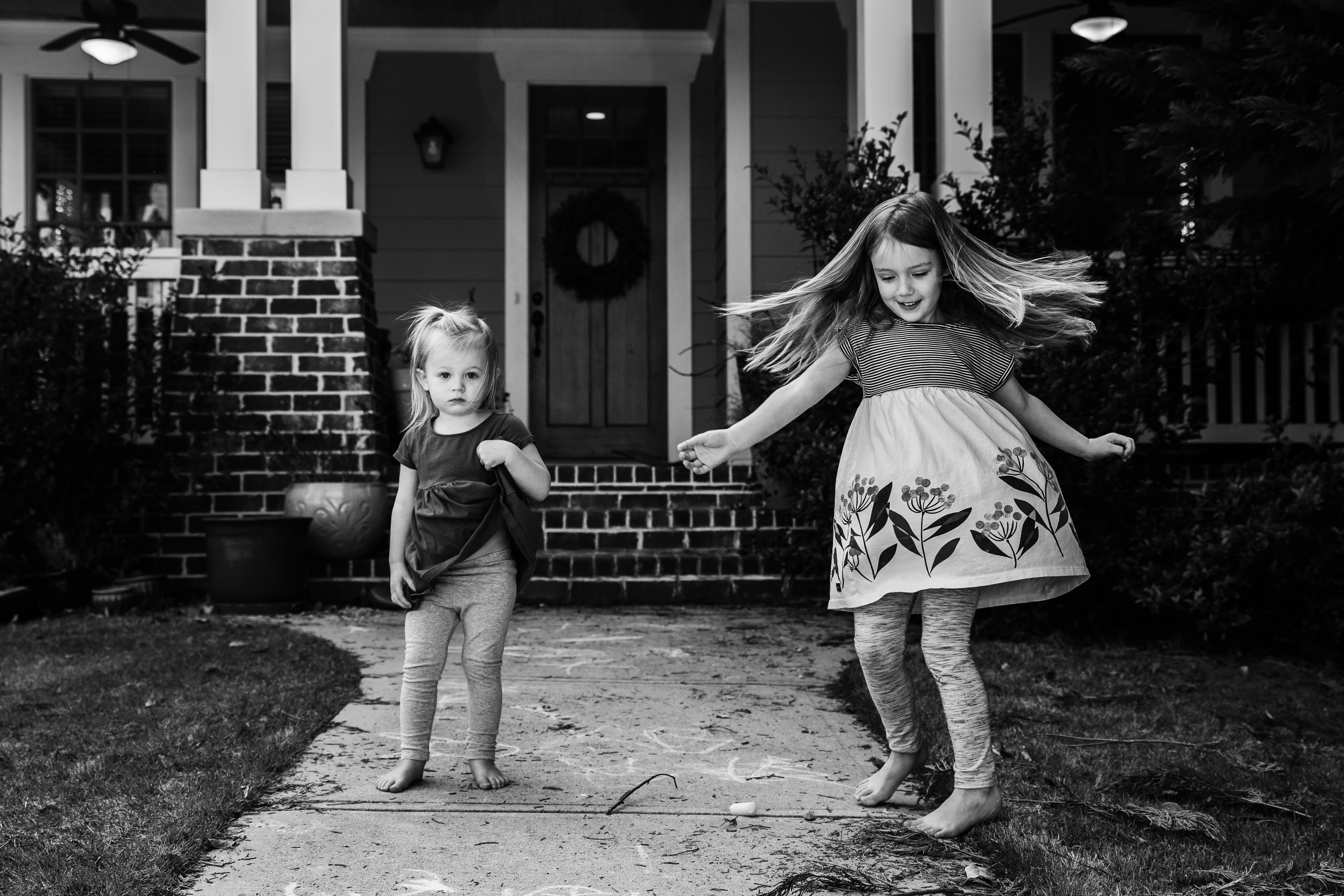 Sisters playing in the front yard