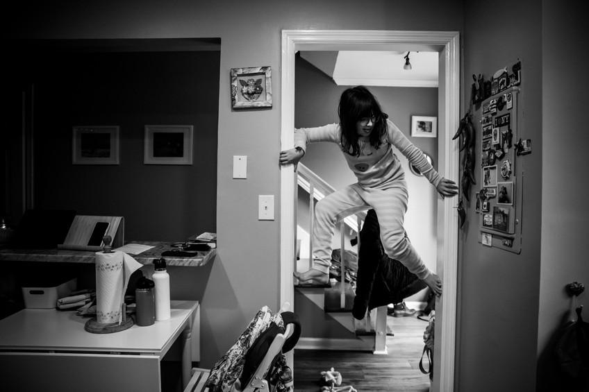 Girl climbing at home