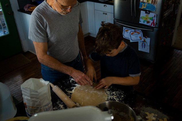 Boy making cookies with grandpa