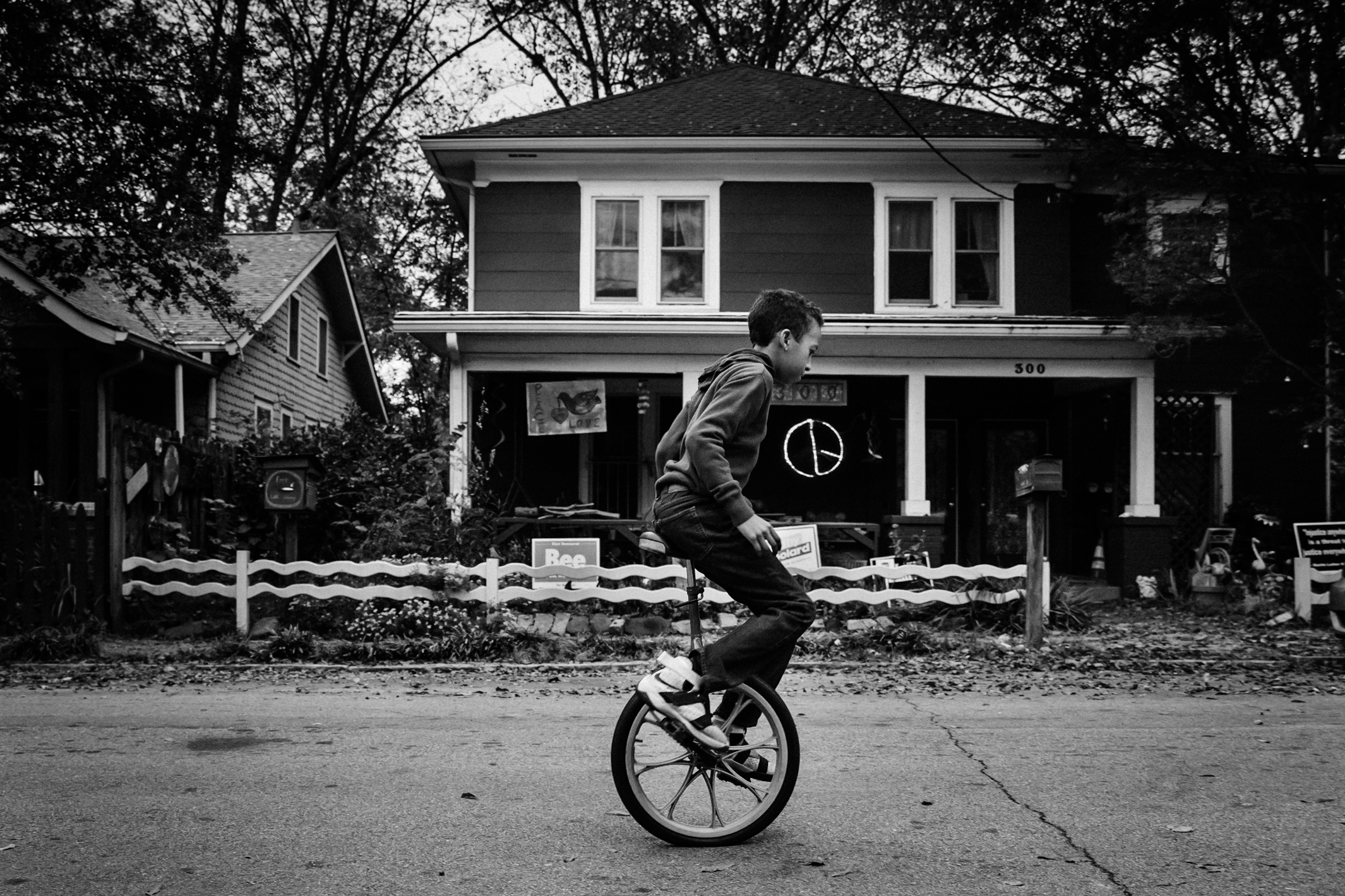 Boy riding his unicycle