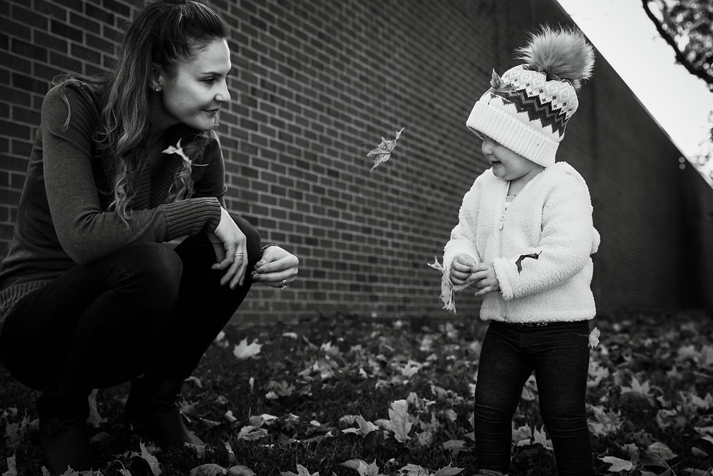 mother daughter in the leaves