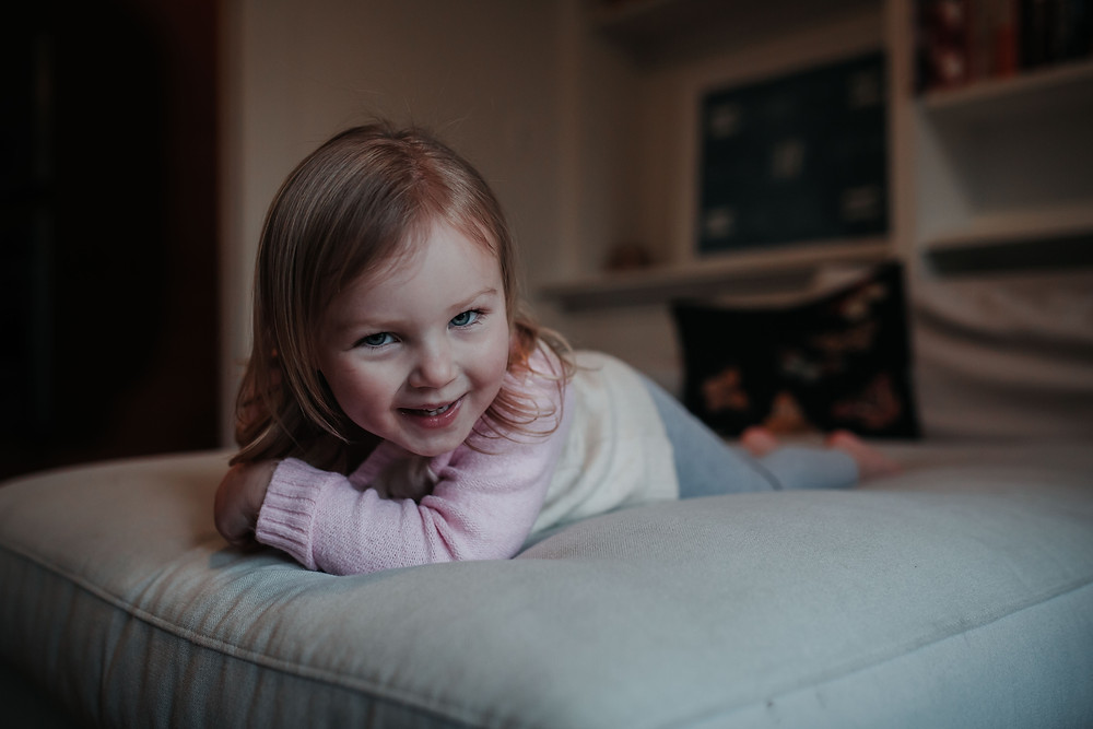 little girl at home on the couch