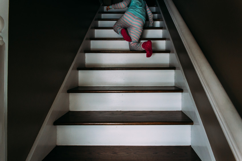 girl on stairs in pajamas