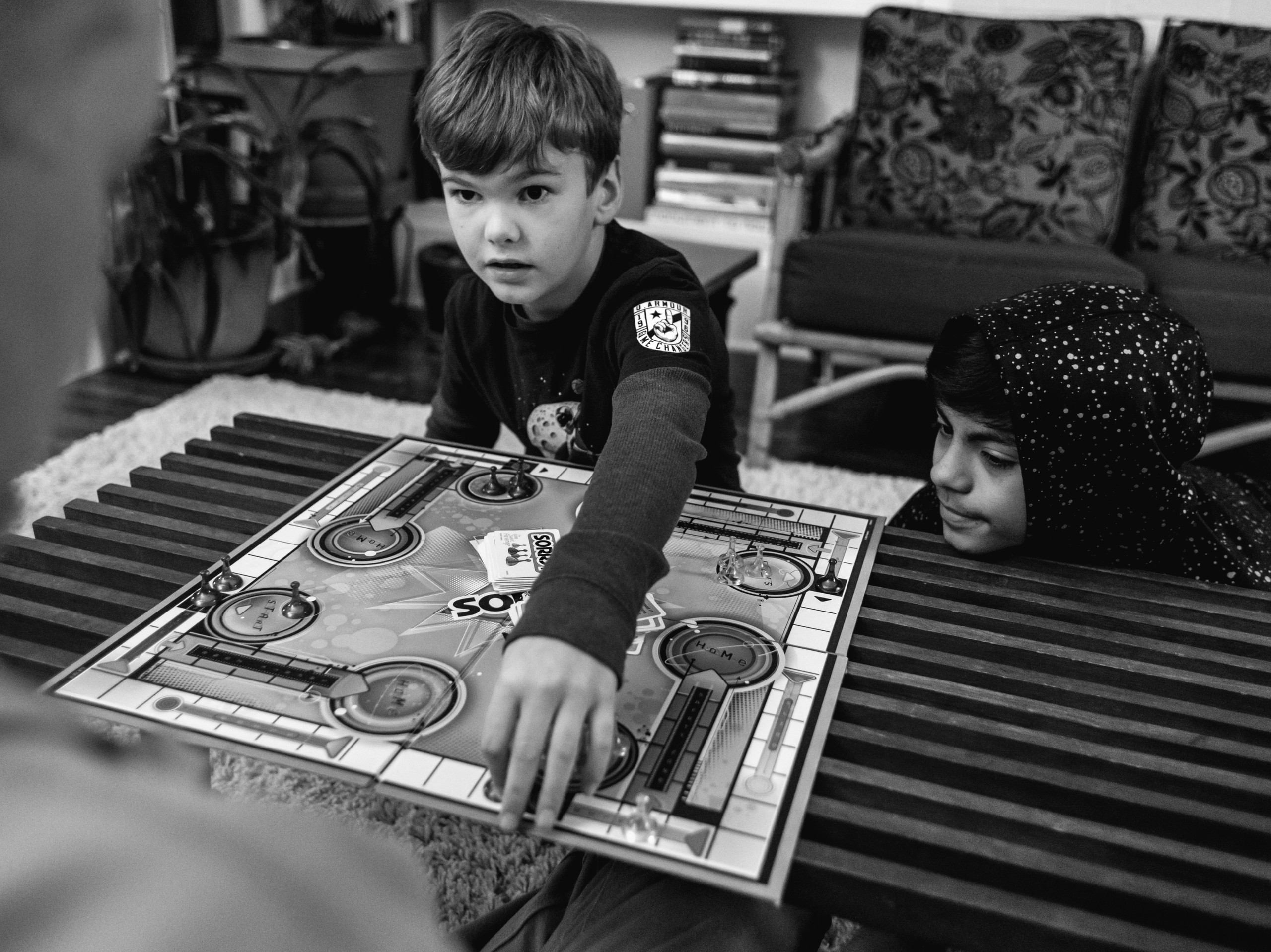 Boys playing board game