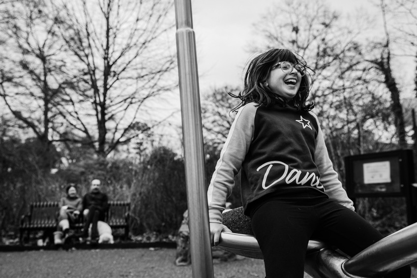 Girl laughing at playground