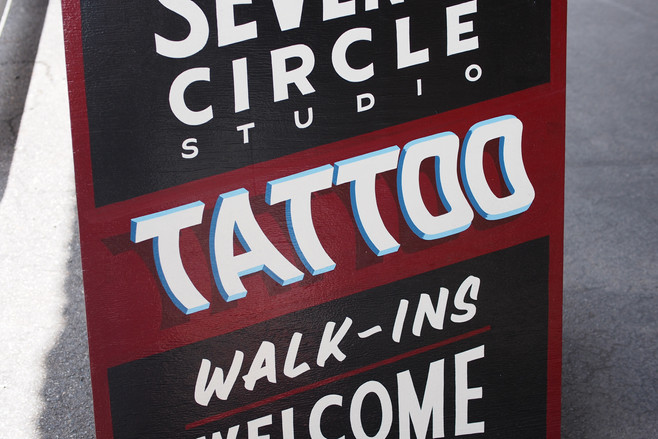 A-frame hand drawn and painted for Seventh Circle Tattoo