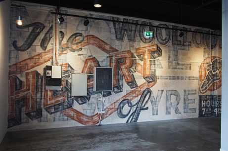 Internal typographic artwork referencing local historic signage for Silk One, Woolloongabba, 14m x 5m