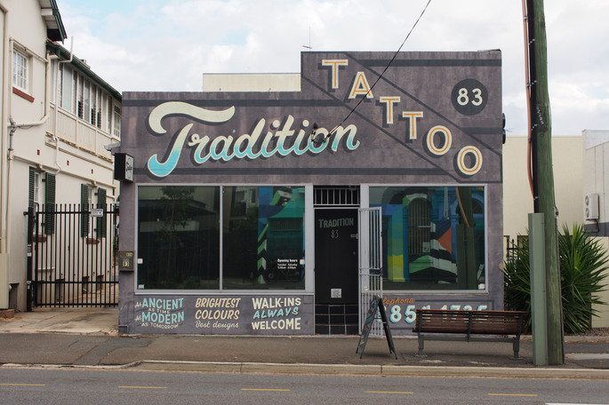 Storefront signage designed and hand painted for Tradition Tattoo