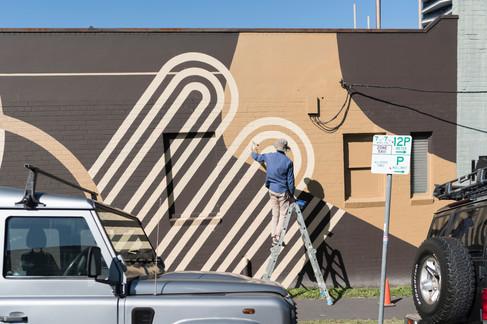 Building artwork for Allpress Coffee Roasters headquarters in Woolloongabba