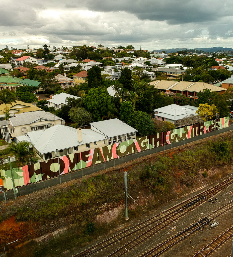 'Home among the gum trees' typographic artwork for Queensland Rail in response to an exisiting artwork onsite, 75m x 3.5m