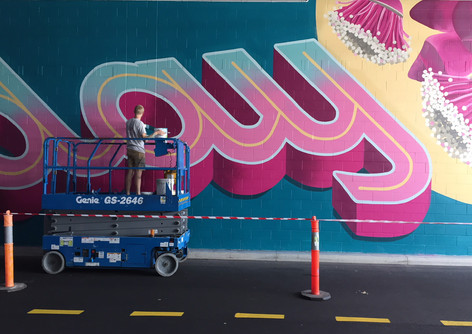 'Escape the everyday' typographic artwork for Pacific Fair, 45m x 5.5m