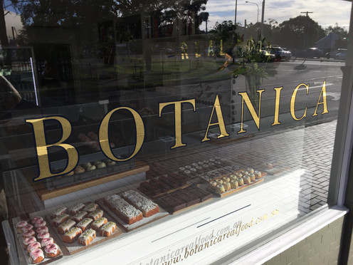 23k Gold with navy blue outlines for Botanica