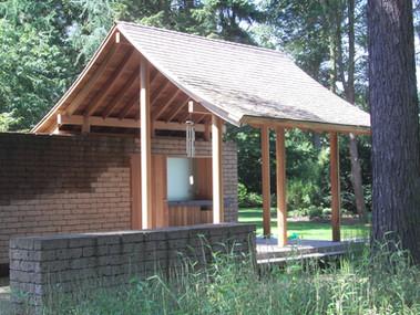 PeetersJef.be - Ceder Paviljoen met ronde houten kolommen en cederen dakleien