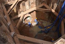 Sewer pipe laying.